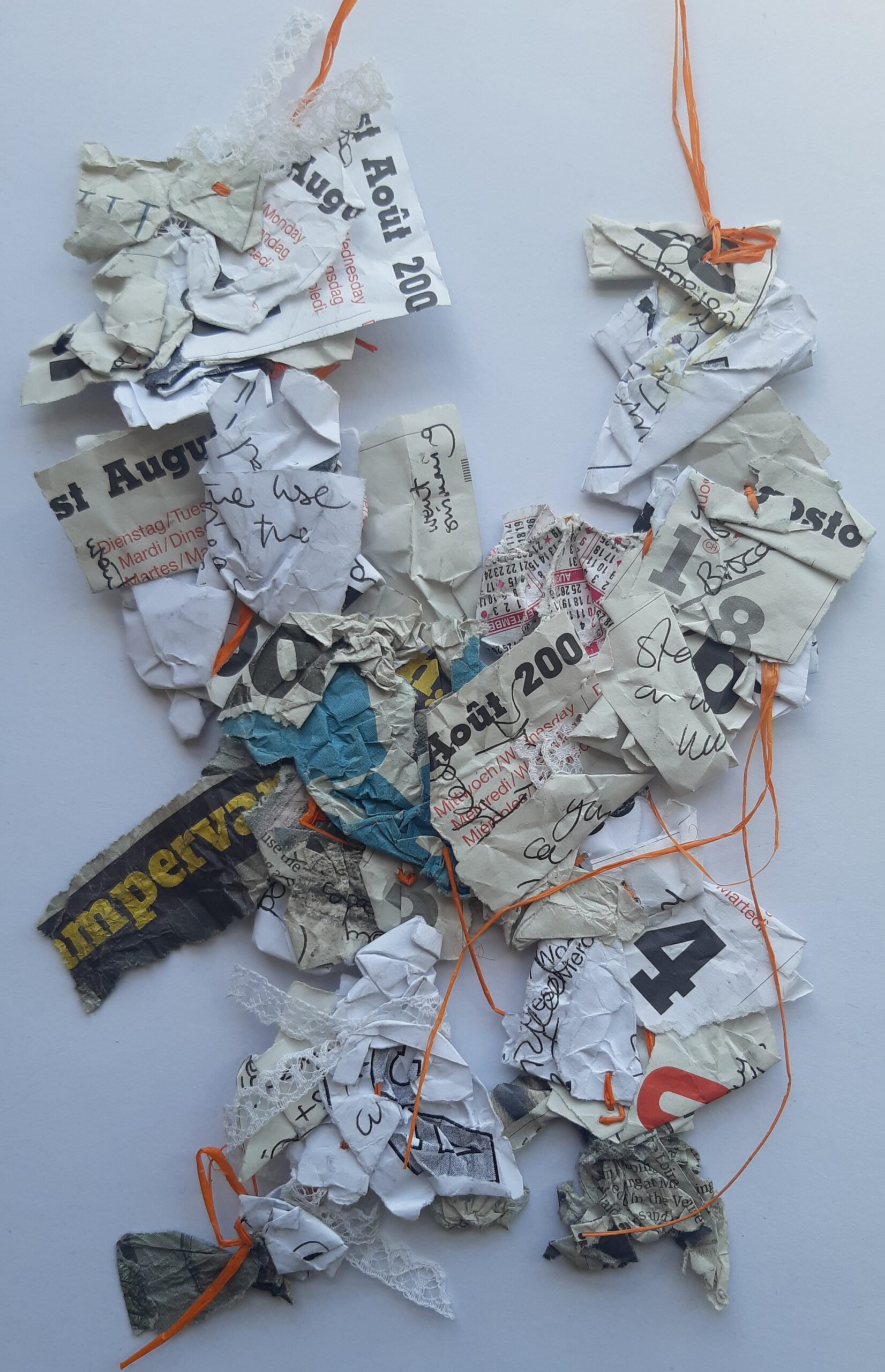 paper and thread work made from found papers.